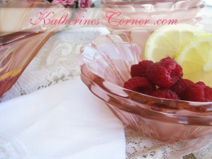 raspberries in pink bowl
